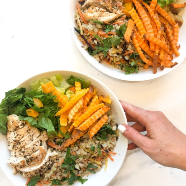 Chicken rice and veggies in bowls