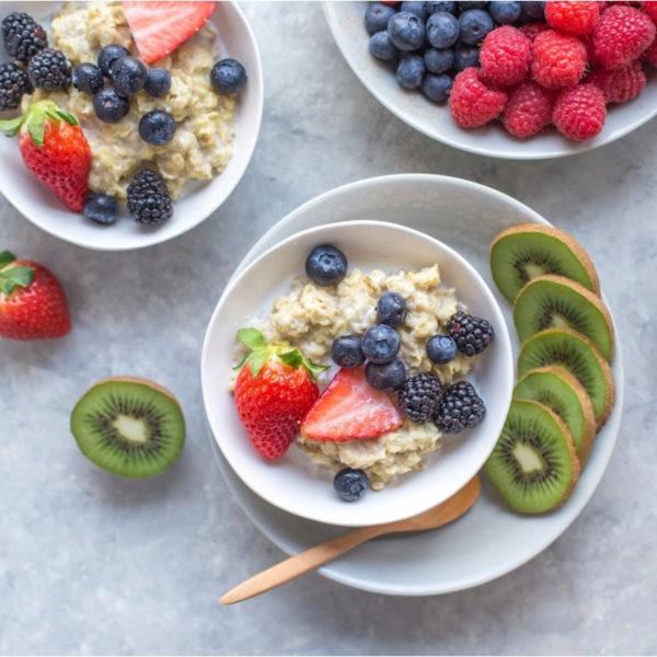 Kiwi around a bowl of yogurt and fruits