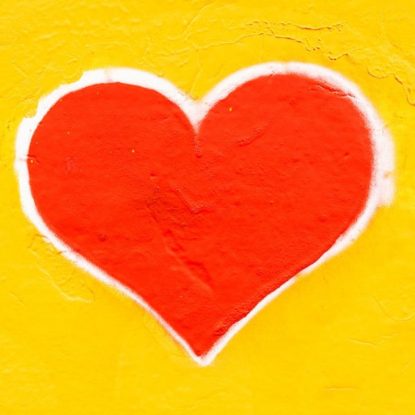 Red heart with yellow wall background