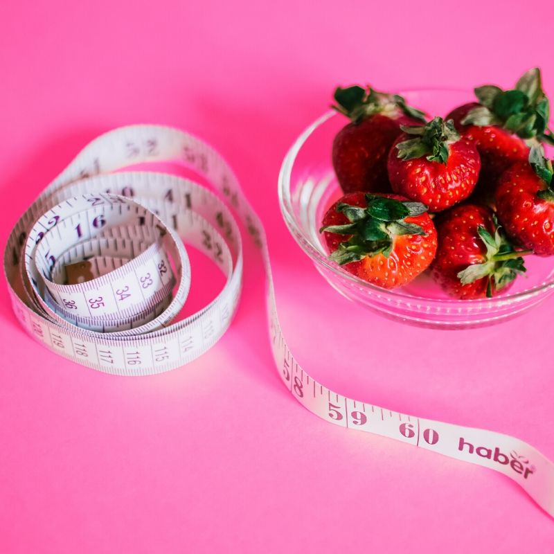 measuring tape and strawberries